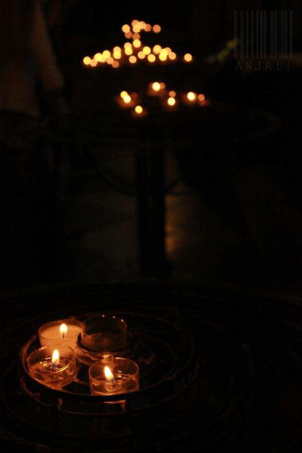 the little lamps that lit the dark church aisle